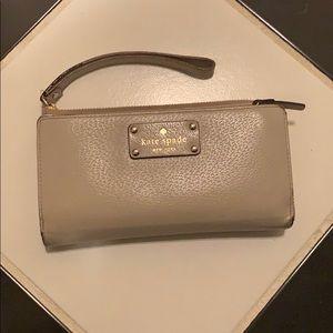 Kate Spade tan/cream wristlet wallet